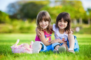 http://www.dreamstime.com/stock-image-two-young-smiling-girls-hugging-grass-image12426141